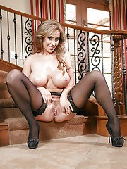 Hot MILF Eva Notty letting hooters free from see thru bra on staircase
