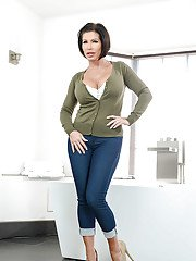 MILF pornstar Shay Fox exhibiting round tits after jeans and bra removal