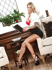 Blonde MILF Synthia Fixx showing off great legs while undressing
