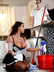 Dark haired maid August Taylor having oral sex with man of household
