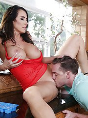 Brunette wife Reagan Foxx engaging in oral sex activities with large dick