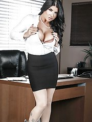 Brunette MILF with huge tits Romi Rain appears naked at the office