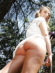 Solo girl Harley Jade inserting vegetables into pussy in the woods