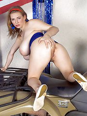 Solo model Christy Marks letting huge hangers fall loose on ATV