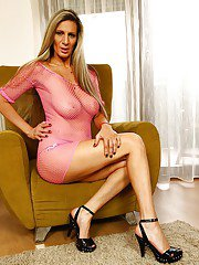Older Euro dame Mercedes Silver releasing large boobs from see thru dress