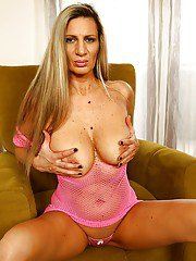 Mature Euro dame Mercedes Silver revealing large tits and wet pussy