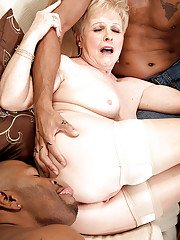 Naughty grandma Jewel giving oral sex to 2 big black cocks at once