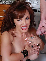 Hot older woman Vanessa engaging in mutual oral sex exchange in kitchen
