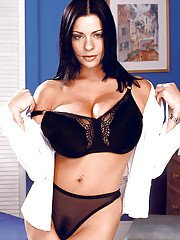 Brunette model Linsey Dawn McKenzie playing with nice melons in teasing manner