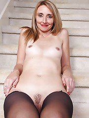 Heidi Van Moore plays with her furry cunt while completely nude