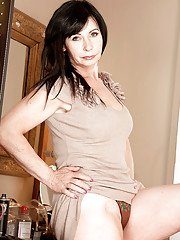 Mature brunette lady Lilly undressing before inserting vibrator in spread cunt