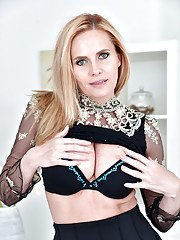 Older blonde lady Lili Peterson revealing big tits while undressing