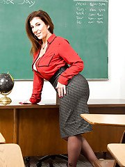 Clothed teacher Sara Jay shucking skirt and pantyhose to pose naked on desk