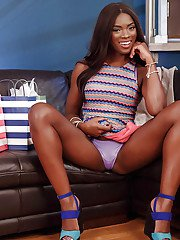 Black solo girl Ana Foxxx showing off great legs while stripping off clothes