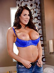 Brunette MILF Reagan Foxx revealing big boobs while undressing in bathroom