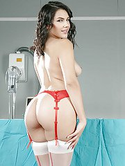 Hot doctor Valentina Nappi stripping off lab coat and panties on exam table