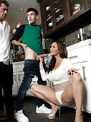Clothed cougar Kendra Lust caught sucking off huge cock by husband in kitchen