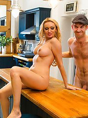 Sexy blonde MILF Amber Jayne jerking and blowing huge dick in kitchen