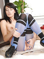 Dark haired solo model Vickie slipping fingers into puffed up twat