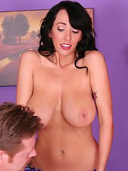 Brunette MILF Alia gives some massage to a guy and takes his cock in mouth