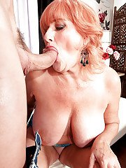 Redhead granny Jackie blows cock and fucks like a real slut in a closeup scene