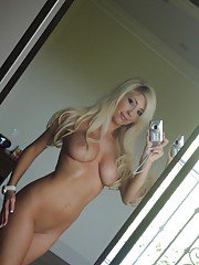 Platinum blonde beauty Tasha Reign taking selfies while getting naked