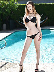 Busty gal Stella Cox gets nude on the poolside boasting of bubble ass and tits