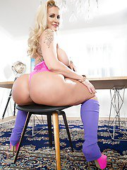 MILF pornstar Ryan Conner showing off big butt and boobs in leg warmers