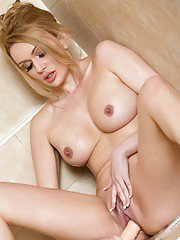 Sexy MILF Amber Jayne sucking and riding large suction dildo in shower