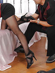 Blonde female Jessie Volt having her hose clad feet worshiped before footjjob