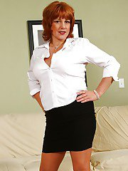 Older redhead Calliste modeling non nude in skirt and pantyhose