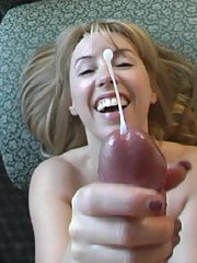 Older housewife Sandra Otterson jerking large cock for jizz facial