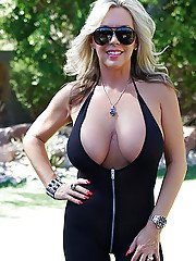 Hot blonde housewife Sandra Otterson flaunting knockers on pool table