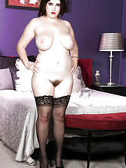 Busty May West shows off her hairy twat and huge tits in rough solo