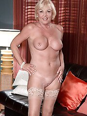 Experienced blonde lady Scarlet Andrews baring big tits and pierced nipples