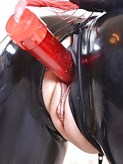 European fetish model Latex Lucy inserting vibrator into shaved pussy