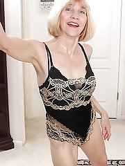 Ugly older woman Bossy Ryder stripping off dress and lingerie to pose nude