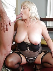 Chubby older woman Lizzy vaunting large breasts while giving blowjob