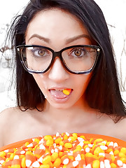 Eating popcorn ends up with some mouth fucking action for a teen in glasses
