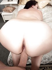 Obese brunette wife Charlotte Angel getting fucked on bed by big penis