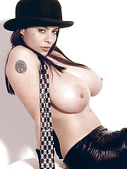 Sexy MILF Linsey Dawn McKenzie posing in micro-skirt and bowler hat