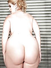 Blonde BBW Rockell undressing in shower and plunging fingers into bald cunt