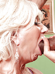 Cheerful blonde granny in black nylon stockings appreciates hardcore sex