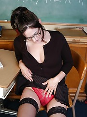 Aged schoolteacher Alexa driving huge dildo up wide open vagina in classroom