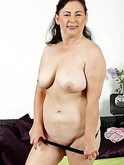 Fat older woman Kata stripping naked on bed to masturbate to orgasm