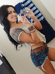 Brunette female Breanne Benson taking selfies in mirror while undressing