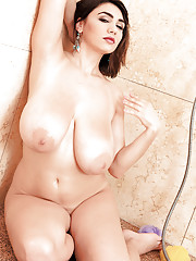 Busty European fatty Alexya soaps her big boobs and a curvy body in a shower