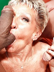 Big boobed granny Sandra Ann having interracial MMF 3some with 2 huge cocks
