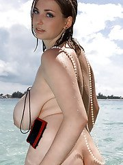 Chubby solo model Christy Marks showing off huge floppers in the water