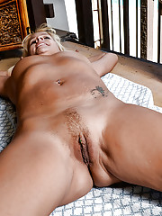 Older blonde woman Payton Leigh spreading bare legs to display pink cunt